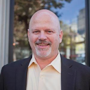 Curtis Olson, Director of Technology, Comrade
